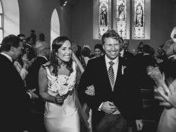 Video Still: An excited couple walk the aisle